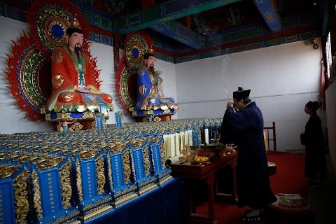 Taoist priest honours China's coronavirus dead with memorial tablets