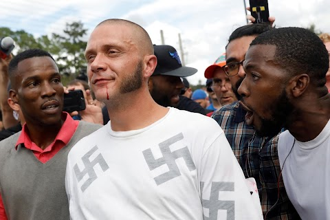 A neo-Nazi in the midst of a protest