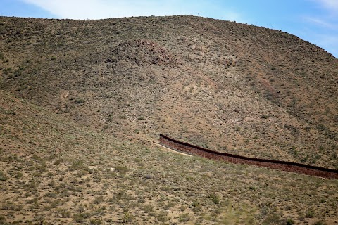 Along the U.S. - Mexico border fence