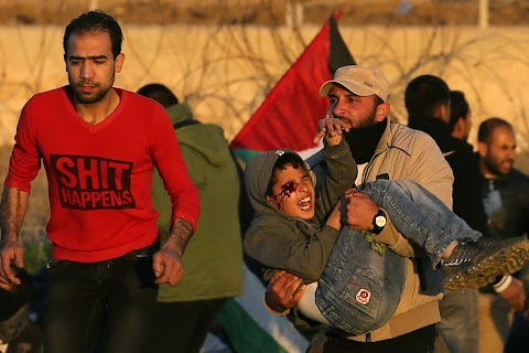 A boy injured in clashes in Gaza