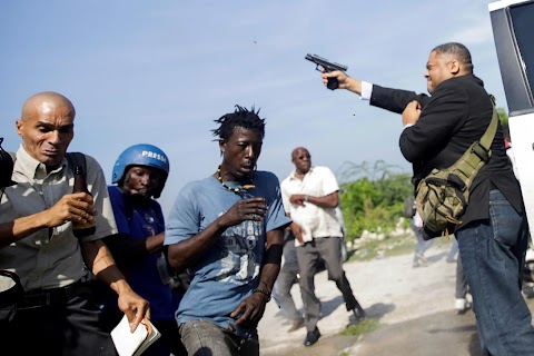 Pistol-packing senators confront Haiti's angry opposition