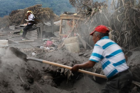 Woman digs for family lost under Guatemalan volcano