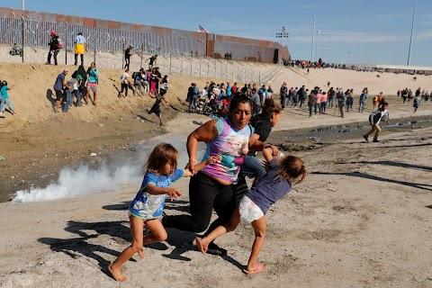 Honduran migrant flees tear gas with her children