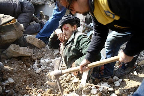 Syrian pulled from rubble mourns 'martyred' son