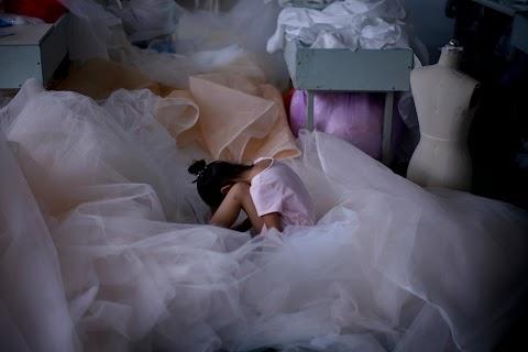 Coronavirus dampens celebrations in China's wedding gown city