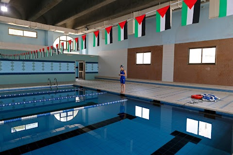 Palestinian swimmer glides past obstacles to reach Rio