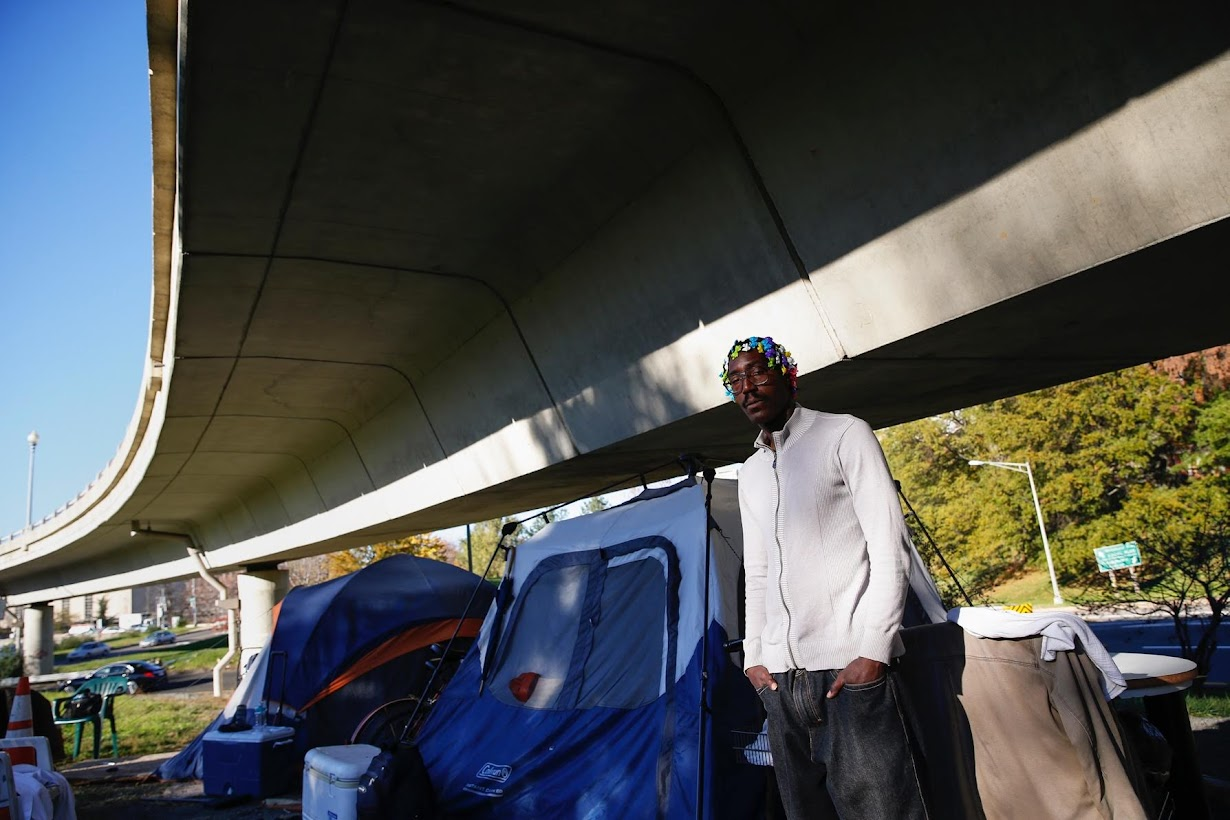 Why would it be good for the town to move all of the homeless people out?