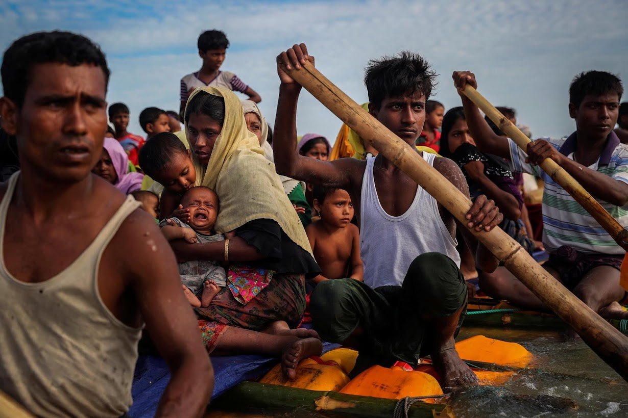 Rohingya refugees cross the Naf River with an improvised raft to reach to Bangladesh in Teknaf.