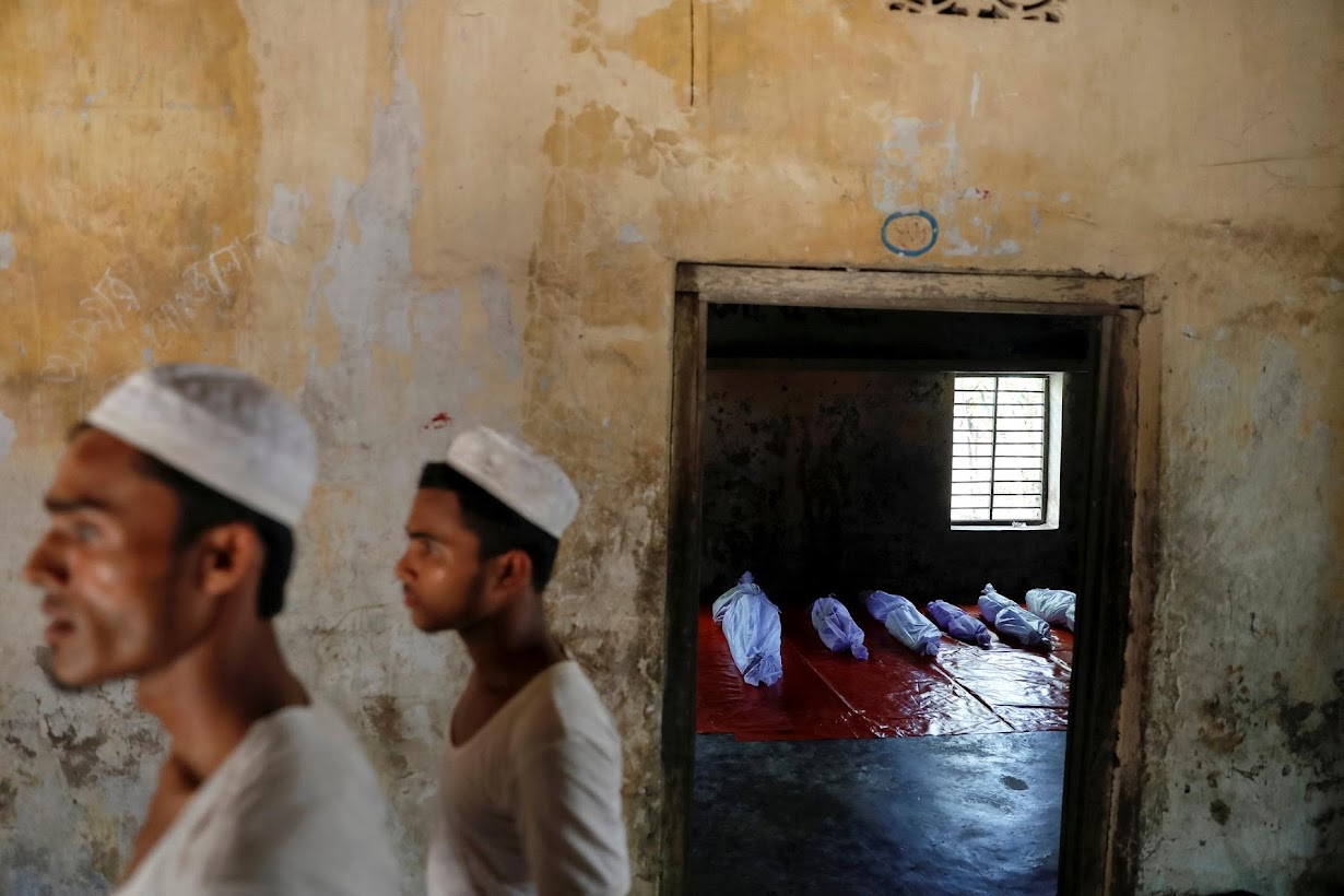 Bodies of Rohingya refugees, who died when their boat capsized while fleeing Myanmar, are placed in a local madrasa in Shah Porir Dwip, Teknaf.