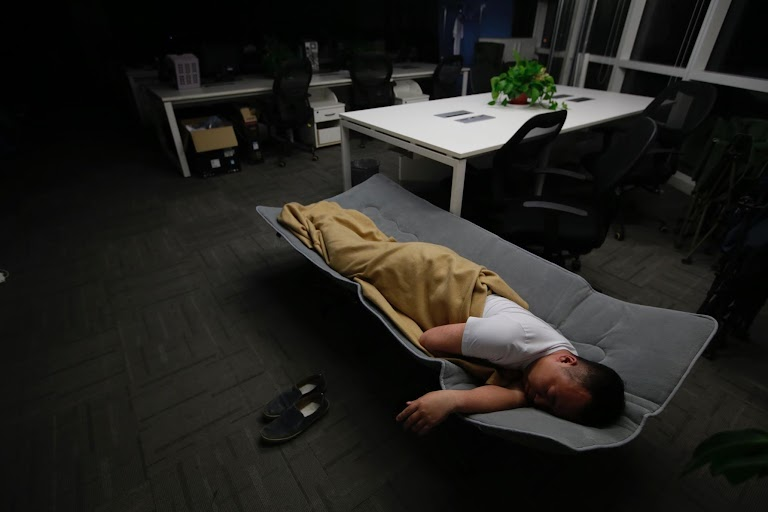 working  eating and sleeping at the office